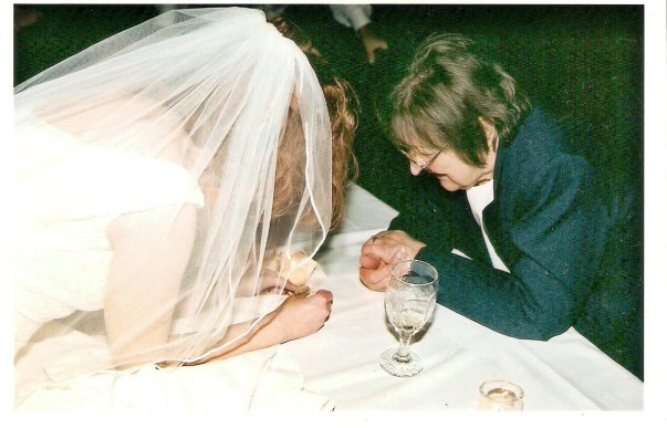 My mom and me having a moment at my wedding.